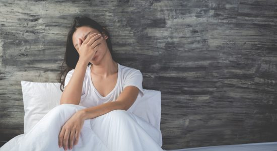 young-woman-is-depressed-white-bed-min-scaled.jpg
